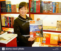 Awesome Collection Of Book Shop News Stand Sales Assistant Holding