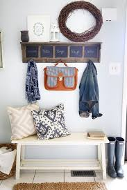 entryway shelf with hooks, chalkboards, and a bench