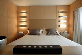 appealing wall sconces for bedroom long lamp set stuck timber wall above the bed