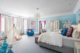 pink and blue girl bedroom with cream mirrored armoire