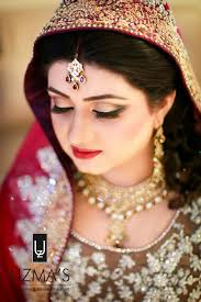 tstani bridal makeup in red color