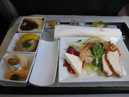 Businessclass Airline meal with tightly arranged plates singleservice  condiments and serving