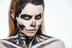 woman with terrifying skeleton makeup over white background