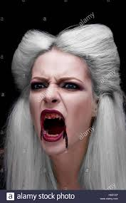 Beautiful Blond Girl Vampire Is Screaming. The Blood Is On The Mouth.    Stock