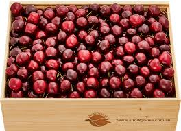 wooden box of red cherries front view
