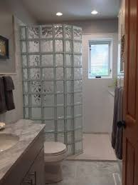 guest bathroom remodel with walk in glass block shower and stone shower pan