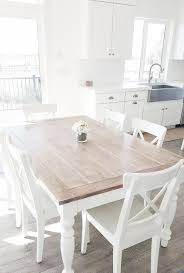 whitelanedecor dining room table liming wax table top stainless steel farm sink white cabinets with br hardware white x back ikea chairs