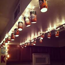 Kyle can opened some busch cans then drilled a hole on the bottom end, and  I doctored them with hot glue to Walmart lights.