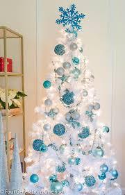 Blue + white Christmas tree . I love the idea of using a white Christmas  tree