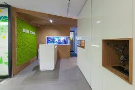 green eco office building interiors natural light. The Entrance Area Has A Striking Green Moss Wall And Large Aquarium That Precisely Embedded In Wood Paneling. Successful Combination Of Natural Eco Office Building Interiors Light S