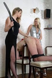 Man disciplined by two femdom women