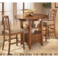 three piece dining set: ashley furniture cross island  piece counter height ext table dining set