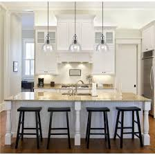 pendant lighting over sink. astonishing glass kitchen pendant lighting over marble top table with attached sink also black wooden stools