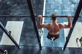 man is working out in crossfit gym