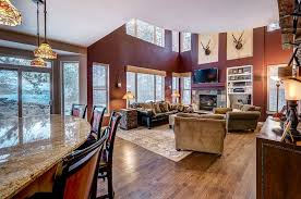 flooring ideas for family room. transitional family room with bordeaux dream granite countertop, carpet, wall sconce, hardwood floors flooring ideas for