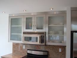 glass look with upper cabinets being in stainless steel and bottom cabinets with modern stainless steel frosted