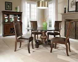 old and vintage glass top round dining tables with pedestal wood base and high back chairs with brown leather seats and low legs ideas