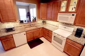 cambria canterbury quartz countertop and tile backsplash traditional kitchen