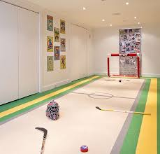 Image Kid Friendly View In Gallery Basement Playroom For An Ice Hockey Fan Decoist Basement Kids Playroom Ideas And Design Tips