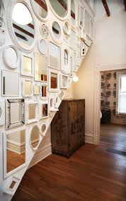 I love this idea. Mirrors with different frames taking up a whole wall.
