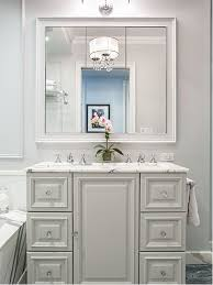 Example of a classic bathroom design in New York with raised-panel cabinets  and white