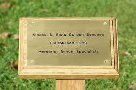 light wood memorial stake with brass plaque engraving