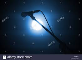 The Bright Spot Lighting Professional Stage Microphone In Bright Spot Light Over Dark