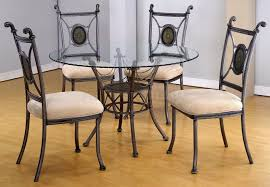 fancy round gl dining table set with brown floor