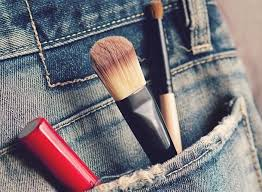with makeup tools in back pocket