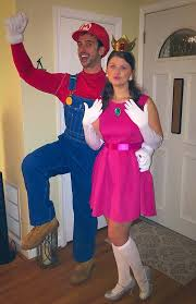 1 looking great in super mario costumes and a princess peach costume