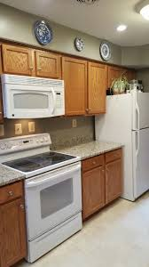 kitchens with white appliances and oak cabinets. Best Granite Color To Tie Together Oak Cabinets With White Appliances-  Blanco Tulum Granite, Gettysburg Grey Paint Kitchens Appliances And I