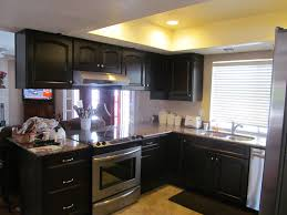 Black Wood Kitchen Table Dark Countertops Kitchens Kitchen Color Ideas Light Wood Cabinets