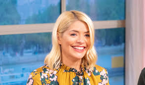 And what better way than a beautiful woman in front of christmas trees and stuff? Holly Willoughby This Morning Live