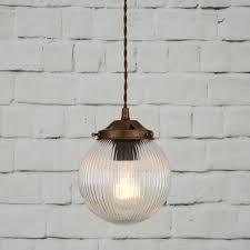 a glass globe pendant light the stanley holophane globe shown in antique brass but