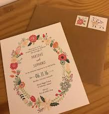 fl wreath ilrations on unique indian wedding invitation
