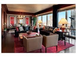 Red Living Room Rug Wall Art Floral Arrangement Chandelier Brown Sofa Oriental Rug