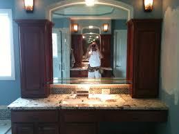 custom made bath vanity with granite tops and custom shelf towers