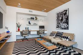 home office living room modern home. tucked in at the back of this living room is a shared home office or homework station for extra lighting builtin wood desk has white lights that modern f