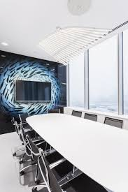 office feature wall. Fish Wall Covering Centering Around The TV On Feature Wall. Office Graphics And Branding. L