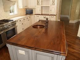classic kitchen design with walnut wood butcher block countertops oil rubbed bronze single handle kitchen