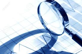 Business Concept Magnifying Glass On Paper Background With Chart