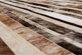 hair on hide detail of a brindle brown and white patchwork cowhide rug