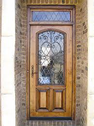 old wood entry doors for sale. old world style wood and iron front door with transom. entry doors for sale e