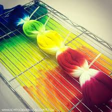 for the rainbow tie dye socks lauri folded them in half then dyed them in rainbow color order notice there s a paper towel underneath the rack to catch