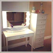 rectangle white wooden vanity table with single drawer combined with rectangle mirror with side lamp