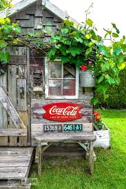 rustic garden shed with old signs by funkyjunkinteriors net