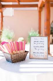 colorful or themed fans are a perfect wedding favor idea for the summer guests will appreciate the extra breeze and can reuse them again and again