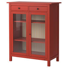 red brown wooden storage with three shelves also double glass doors plus double drawers and short