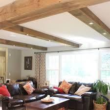 open beam ceiling lighting. if you want to install downlights but have a solid concrete slab or flat roof above adding faux beams allows fit into the open beam ceiling lighting i