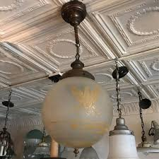 1920s federal style acid etched frosted glass globe pendant light depicting american
